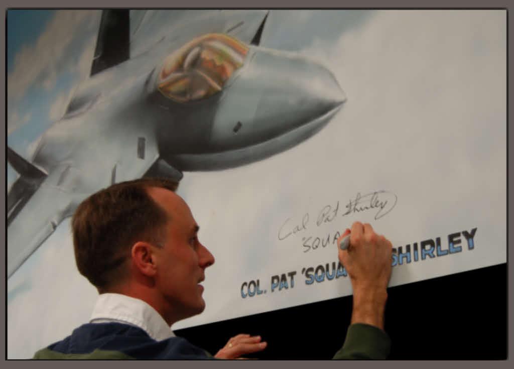 Pat signing Mural